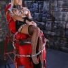 Chained Tgirl hottie Natalie Foxx posing